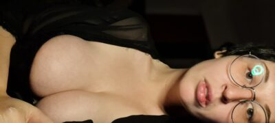 Cropped photo of Laura Palmer from eyebrows to chest, her breasts half out of her top. NZ Pleasures.