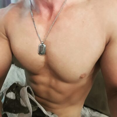 Close up photo of Seth's chest and stomach, topless. NZ Pleasures.