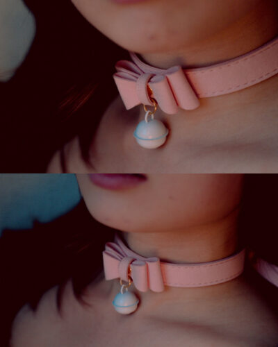 Close up photo of Nala Ren's neck, wearing a pink collar with bow and bell. NZ Pleasures.