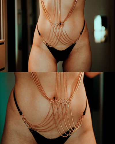 Nala Ren from waist to lower thighs standing with legs slightly apart. Nala wears black lingerie with gold body chain. NZ Pleasures.
